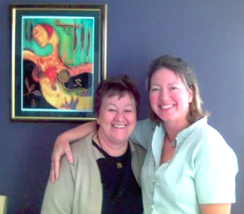 Dr Boyd with Angela and a framed print of Angela's Original Artwork Isobel. Paint 2 Relax. Paint to Relax.